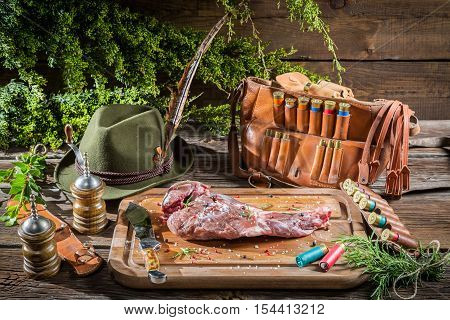 Venison marinated immediately after the hunt on old wooden table