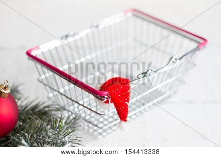 Christmas and empty shopping basket abstract concept