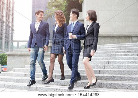 Group of businesspeople walking down the stair in hongkong