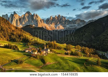 Santa Maddalena village in front of the Geisler or Odle Dolomites Group on sunset Val di Funes Italy Europe.