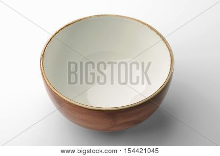 Ocher hand-crafted chinese bowl isolated on white background