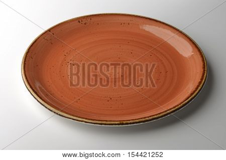 ocher hand-crafted plate isolated on white background