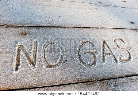 No Gas Written On A Wooden Background With Frosts