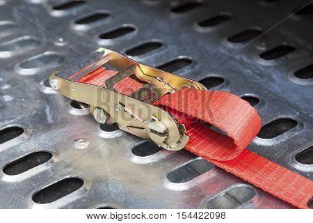 Closeup of a secure truck load belt