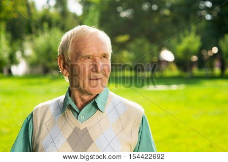 Man looking to the side. Older male outdoors. We change as time passes. Live your life.