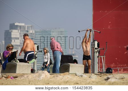 Barcelona Spain - October 30 2016: Locals and tourists doing outdoor sports on an untipcally warm and sunny mid autumn sunday on Nova Icaria and Bogatell beaches
