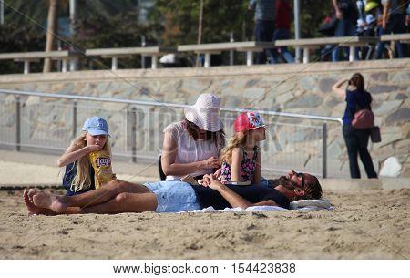 Barcelona Spain - October 30 2016: Tourists enjoying an untipcally warm and sunny mid autumn sunday on a crowded Nova Icaria beach