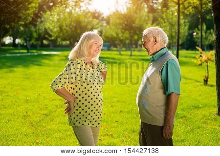 Elderly man and woman outdoor. People on park background. Love and understanding. Life is better with you.