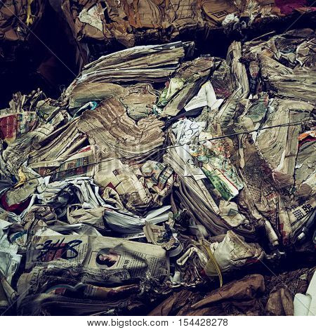 Hong Kong - October 2016: Old newspapers squeezed for recycling. Kowloon.