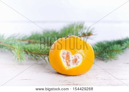mandarin with carved heart,mandarin on white christmas background