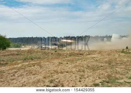 Rocket artillery firing the targets from defiladed position during military training in the field