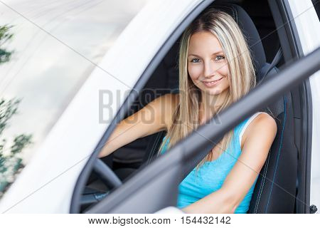 Young Woman Behind The Steering Wheel