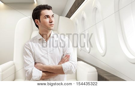 Young Man In Business Class Of A Plane