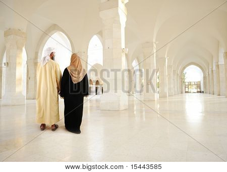 Muslim arabic couple inside big oriental empty modern building. Note: very large resolution.