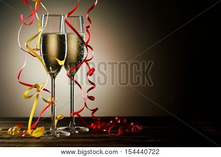 Two glasses with sparkling champagne and festive decoration