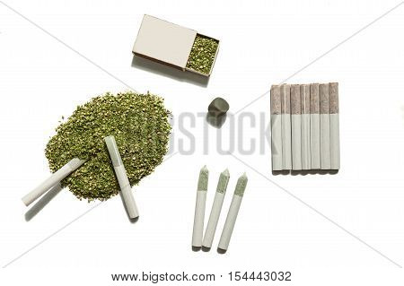 Weed for smoking.The cannabis filled in the box the pile on the table with two rolled cigarettes of hemp seven cigarettes of tobacco and five a of cannabis.
