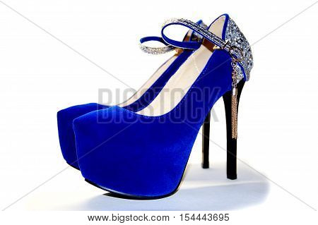 Beautiful Women's high-heeled shoes blue velvet, isolation.