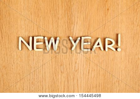 Wooden background for the new year. The text of the New Year