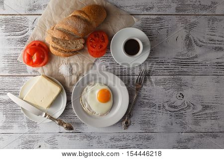 dish of fried eggs with bread and coffee