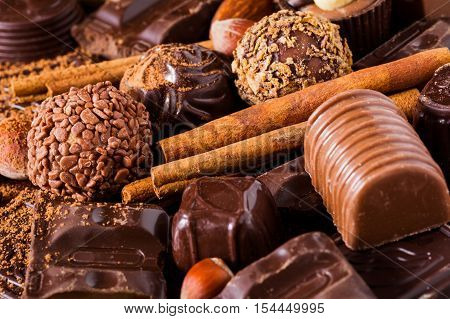 Assortment of chocolates, truffles, candies, chocolate barks, spices and nuts. Luxury chocolates.