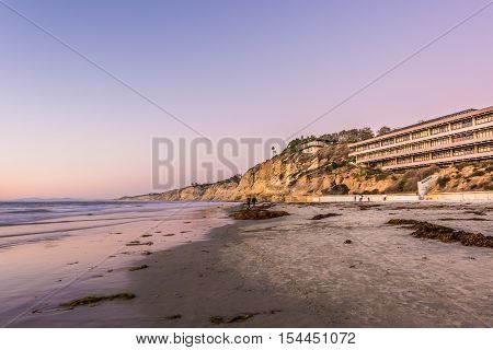 La Jolla, USA - November 7, 2015: Purple sunset on beach with Hubbs Hall at Scripps Institute of Oceanography in San Diego, California