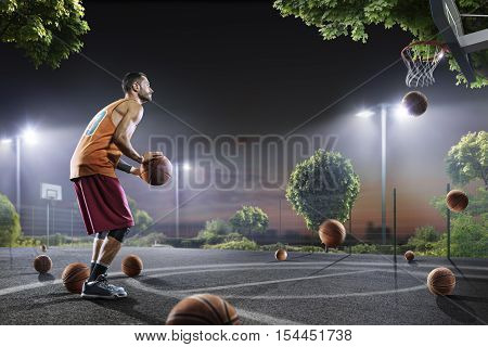 Streetball player is training on night court