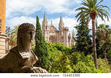 Cathedral of Santa Maria in Palma. Statue of the Sphinx in the background of the Cathedral of Santa Maria in the city of Palma de Mallorca. Spain