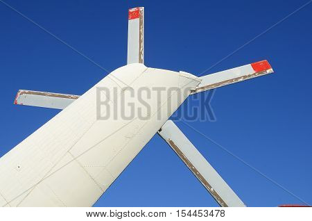 The blade (screw) of white helicopter on a clear blue sky