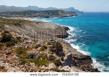 Mountain Coast. Mountain Mediterranean coast with wild vegetation and the raging waves crashing on the foot of the mountains