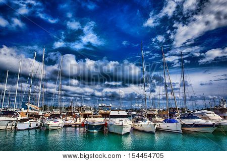 Corfu, Greece - October 21, 2016: Sailing ships and yachts moored in the port of Corfu Greece