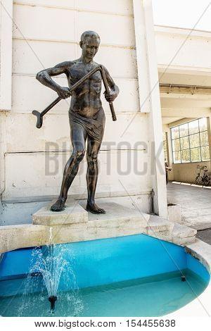 Crutch breaker statue Piestany Slovak republic. Famous spa. Symbolic object. Art scene. Vertical composition.