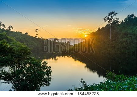 View of swamp and hills during sunset in rural of Thailand.