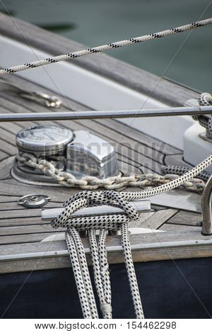 Vintage picture of beautiful sail boat details. Rope hull rigging sailing yacht background