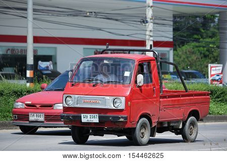CHIANGMAI THAILAND - OCTOBER 9 2016: Private Old Mini Pick up Truck Suzuki Carry. On road no.1001 8 km from Chiangmai city.