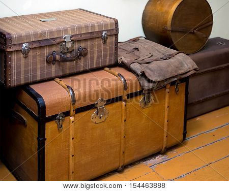 Large antique boxes for storing things stand on the wooden floor
