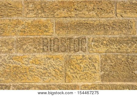 A background of tiled sandstone pattern texture.