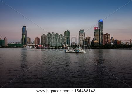 SHANGHAI CHINA - AUGUST 29 2016: Twilight view of Shanghai skyline and the Huangpu river Shanghai China on August 29 2016.