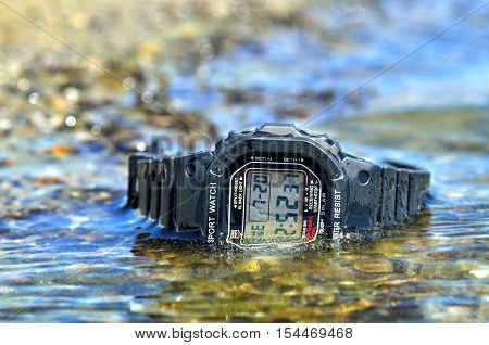 Electronic Waterproof Watch, Immersed In The Water Stream.