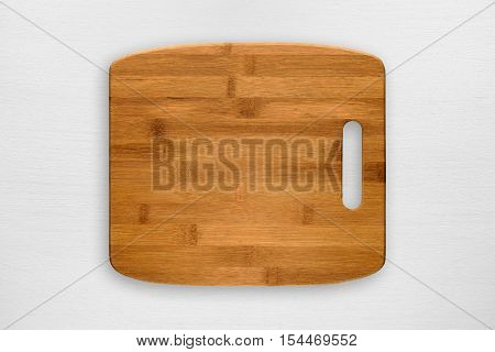 Chopping board on white wooden table top view