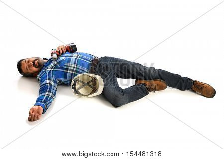 Hispanic worker laying injured on floor isolated over white background