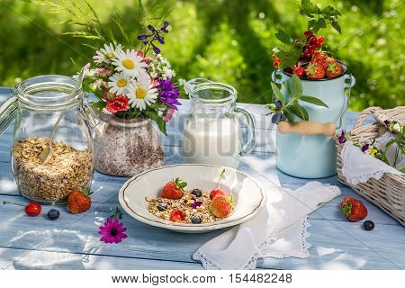 Healthy breakfast with fruit and milk on old wooden table