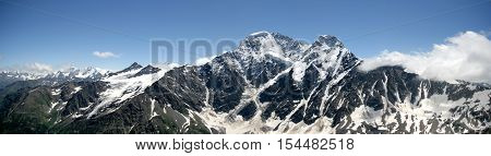 A view of the surroundings from the Che-Get mountain near Elbrus. Russian and the Caucasus border. The famous Caucasian ridge. Kabardino-Balkaria.