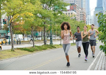 Group of joggers exercising in Manhattan running track