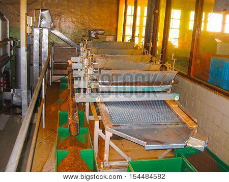 Nuvara Eliya Sri Lanla - May 03 2009: The tables and bags with tea leaf crop on Mackwoods Limited PVT tea factory for weighing in Nuwara Eliya Sri Lanka.