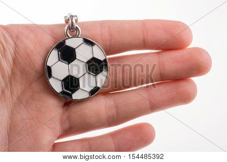 Key holder with a black and white soccer ball in hand