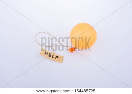 Help Word Written Paper Attached To A Balloon