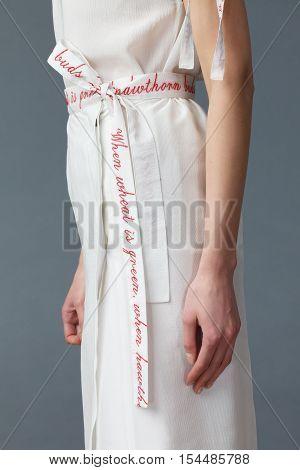 Portrait Of Young Elegant Woman Dressed In Beige Silk Dress
