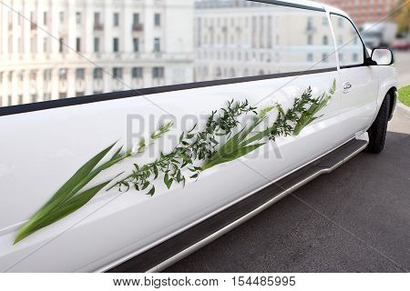 Luxury wedding car decorated with flowers.  Limousine