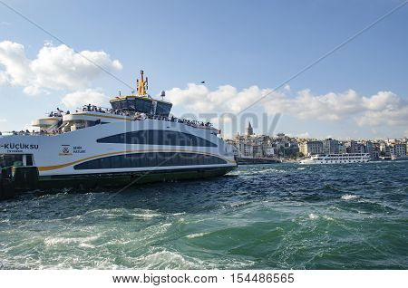 Istanbul Turkey - July 26 2016: Istanbul Eminonu pier and new types of boats. The symbol of Istanbul Galata bridge and Galata tower appears Istanbul views