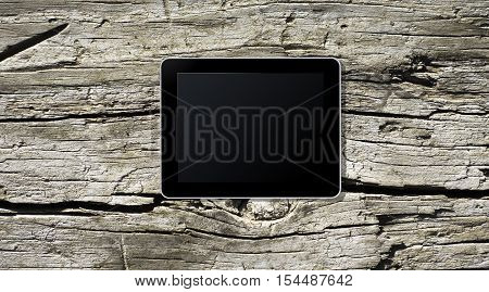 Tablet PC on a wooden board for advertisment
